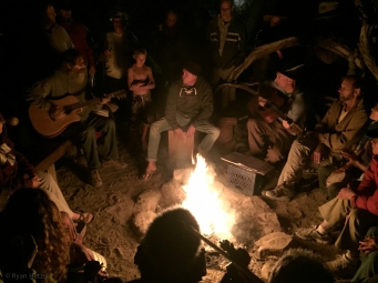 The camp fire crowd jammed into the night