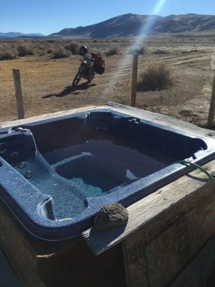 Secret hot spring that this guy showed me (after giving me beers!). He and a buddy had trucked the hot pool in. Super awesome site.